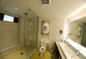 With a rain shower, back lite mirror, and beautiful sink, the bathroom is stunning.